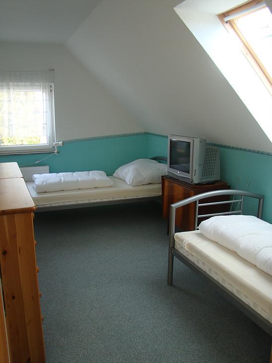 1. Schlafzimmer OG Ferienhaus zu Wohlsborn bei Weimar